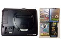 SEGA Mega Drive console with 2 controllers 3 games