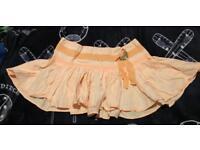 Lovely pleated peach mini skirt River Island size 10 like new