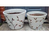 A pair of glazed plant pots
