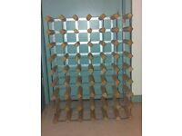 48 bottle wine rack,light wood, fully assembled- Nearly new condition- Wall mounted or freestanding