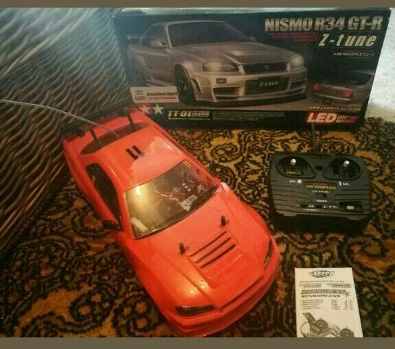 Tamiya tt 01 led Nismo R34 brushless Rc carin Street, SomersetGumtree - Tamiya tt 01 chassis with a nismo nissan GTR R34 shell, has working led lights, comes with a Carson Dragster Sport Brushless sensorless motor, its very quick. Includes a battery and controller, its a rare car not seen one with the same motor. No...