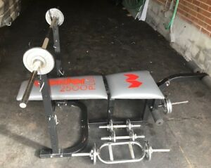 Weider home weight gym with bench and weight plates