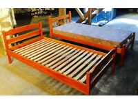 2 solid single pine beds
