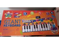 Giant walk on piano toy brand new in box £6