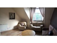 Large West End flat with bay windows, dining kitchen and attic room.