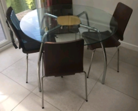 John Lewis glass-topped table & 4chairs. Can deliver