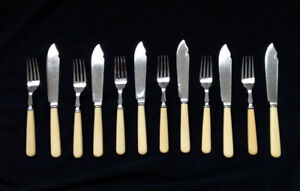 Silver wear: Fish knifes and forks