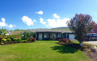Gorgeous Rancher with Lake and Valley View Backing onto Orchard
