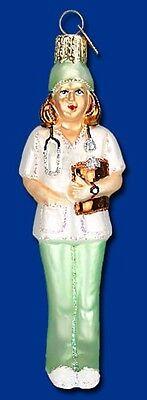 NURSE IN GREEN SCRUBS OLD WORLD CHRISTMAS MEDICAL THEME GLASS ORNAMENT NWT 10203 (Nurse Ornaments)