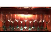 Set of green stemmed wine glasses & champagne flutes