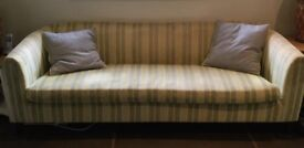 Green striped sofa in good condition.