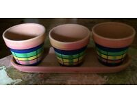 Set of 3 rustic plant pots with stand