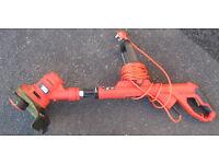 Black & Decker ST 4525 corded grass strimmer. extendable handle.