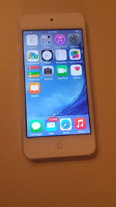Apple iPod touch 5th gen with OtterBox like case and earphones