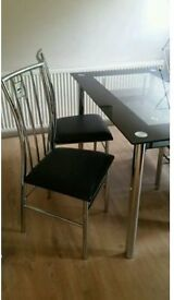 Black Glass and Chrome Dining Table and 4 Chairs