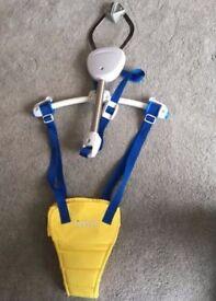 Yellow Lindam baby door bouncer.