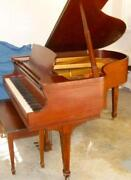 Walnut Grand Piano