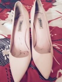 used and used again pink color leather hing - heels