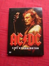 AC/DC LIVE AT DONINGTON DVD PLUS BOOKLET. GREAT CONDITION