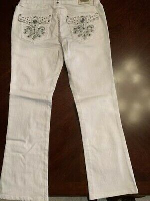 Miss Chic Ladies Designer Jeans size 9. White, With metal and rhinestone studs.