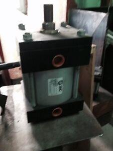 "new SMC pneumatic cylinder. 6.5 x 6.5 x 4"" str, 1-1/4"" shaft"