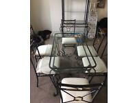 modern glass top table & 6 chairs with matching display unit delivery available
