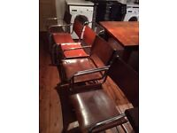 2 X original cantilever leather dining chairs (can be sold separately)