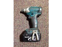 makita impact driver BTD 140, with 1 18V 3.0AH battery and a charger