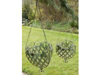 a pair of brand new hanging baskets in a robust metal rococo style 1 large and 1 medium,unused.