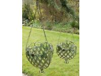 a pair of robust metal rococo style hanging basket,brand new 1 large 1 medium.
