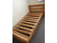 Pine single bed in good condition Can deliver