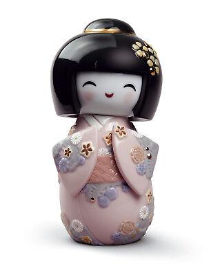 LLADRO Porcelain : SET OF 4 KOKESHI DOLLS Size: 14x9 cm for each figurine.