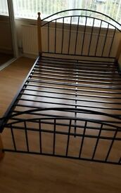 Metal double bed with wooden leds