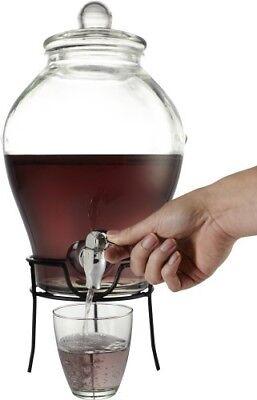 Dispensador de bebidas.con tapa en vidrio.Soporte y grifo metálicos