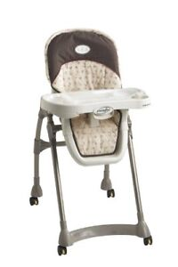 Even flo high chair with locking wheels/ adjustable seat height