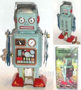 Robot jouet wind-up vintage en tôle dans sa  boite original