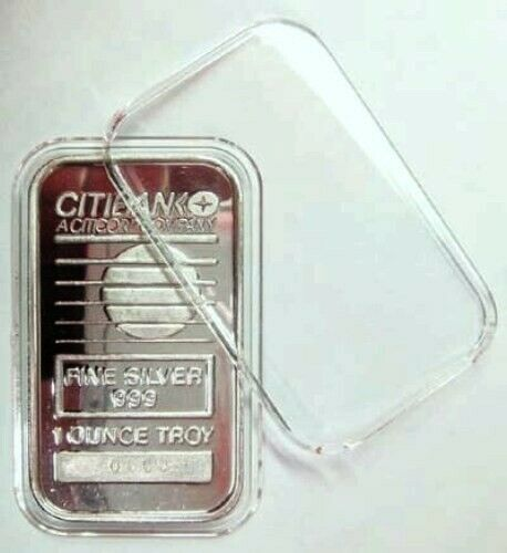 Common 2 ounce Silver Round. Capsule 1 Air Tite X6