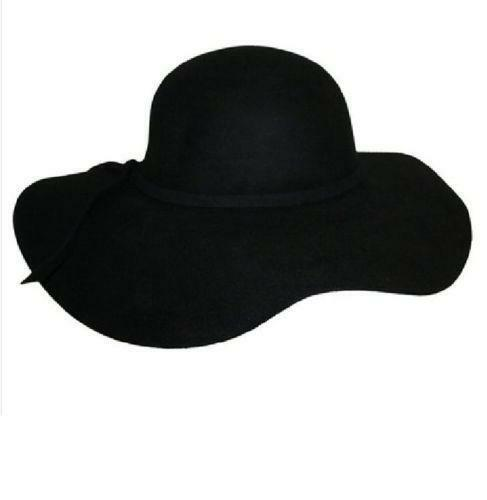 J Lo's wide brim, floppy hat became a symbol of bold, urban design mixed with casual, understated tones. Bollman's Floppy Hat features a round crown with a wide brim in a loden green colored felt with a contrasting wine colored grosgrain ribbon hatband. Approx. 3 3/4