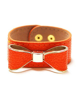 Coral Leather Snap Bracelet With Ribbon Bow Design and Gold Toned Accents Coral And Leather Bracelet