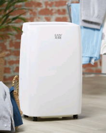 Dehumidifier with built in fan and clothes drying function