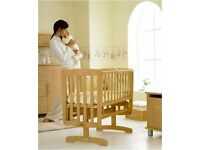 Mamas and Papas Deluxe swinging crib.