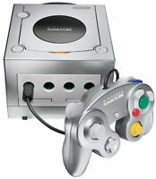 SILVER GAMECUBE COMES WITH TWO CONTROLLERS AND FOUR GAMES.