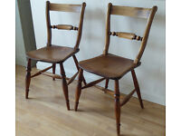 A pair of Victorian bar back kitchen chairs.