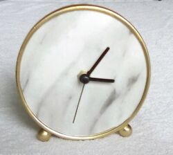 Unique Table Clock with Nice Clock Face. Has a second hand. Uses 1 AA Batery