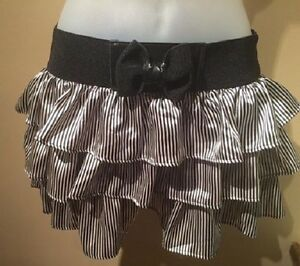 TIERED BLACK AND WHITE MINISKIRT WITH BOW - SIZE SMALL