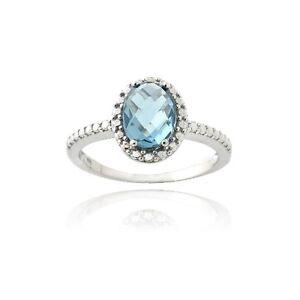 anello-ovale-in-argento-925-1-5-ct-blu-londra-topazio-e-diamante