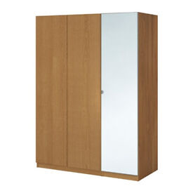 Large Oak effect Ikea Pax wardrobe. 3 doors with full length Mirror and internal drawers.