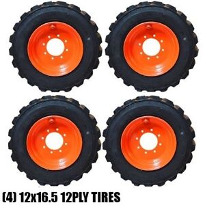 NEW 12X16.5 TIRES WITH RIMS 12 PLY BOBCAT CAT LOADER TIRE