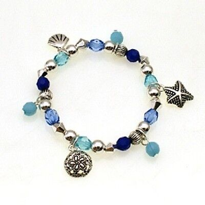 Childrens Silver Toned and Blue Beaded Stretch Bracelet With Ocean Sea Charms