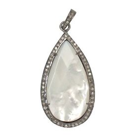 MOTHER OF PEARL IN SILVER SURROUNDED BY SPARKING STONES